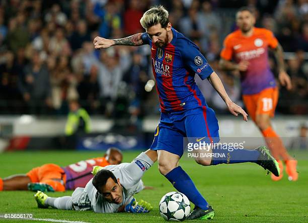 TOPSHOT Barcelona's Argentinian forward Lionel Messi shoots to score a goal beside Manchester City's Chilean goalkeeper Claudio Bravo during the UEFA...