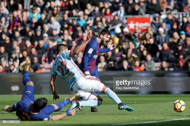 Barcelona's Argentinian forward Lionel Messi shoots to score a goal during the Spanish league football match FC Barcelona vs RC Celta de Vigo at the...