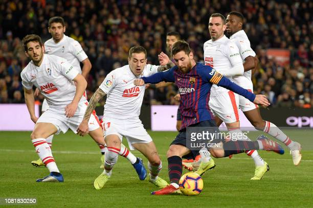 Barcelona's Argentinian forward Lionel Messi shoots to score his team's second goal during the Spanish League football match between FC Barcelona and...