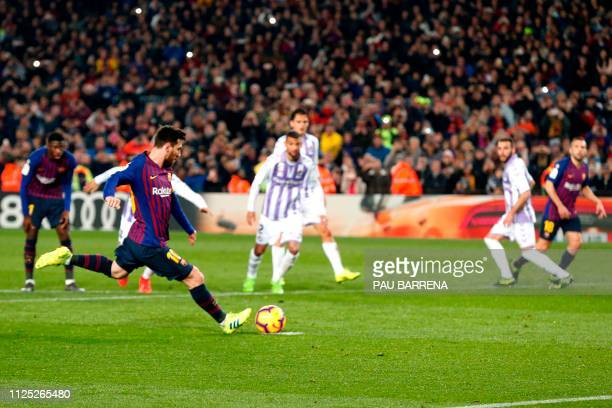 Barcelona's Argentinian forward Lionel Messi shots a penalty kick during the Spanish League football match between Barcelona and Real Valladolid at...