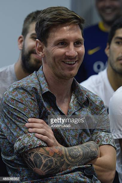 Barcelona's Argentinian forward Lionel Messi smiles during a farewell press conference for Barcelona's former forward Pedro Rodriguez's departure...