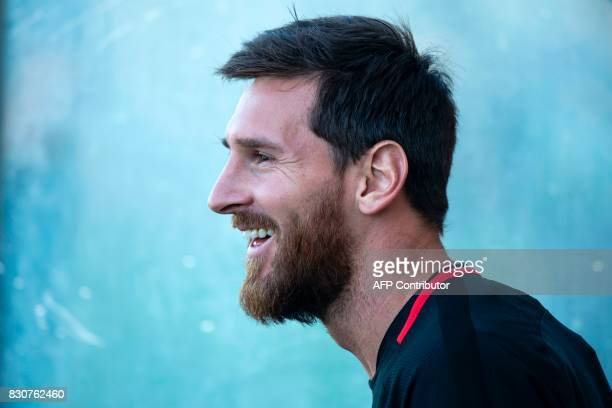 Barcelona's Argentinian forward Lionel Messi smiles during a training session at the Sports Center FC Barcelona Joan Gamper in Sant Joan Despi near...