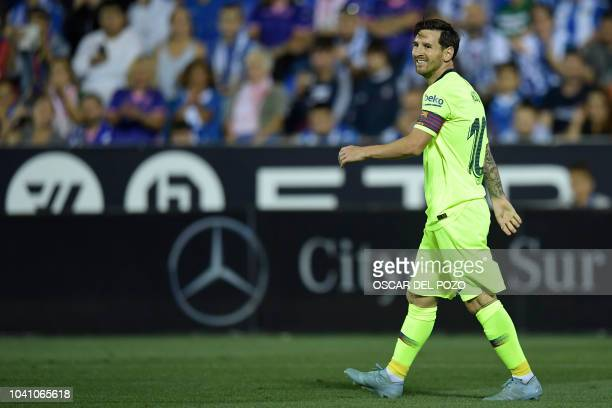 Barcelona's Argentinian forward Lionel Messi smiles during the Spanish league football match Club Deportivo Leganes SAD against FC Barcelona at the...