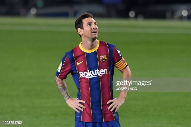 TOPSHOT Barcelona's Argentinian forward Lionel Messi smiles during the Spanish league football match FC Barcelona against Villarreal CF at the Camp...