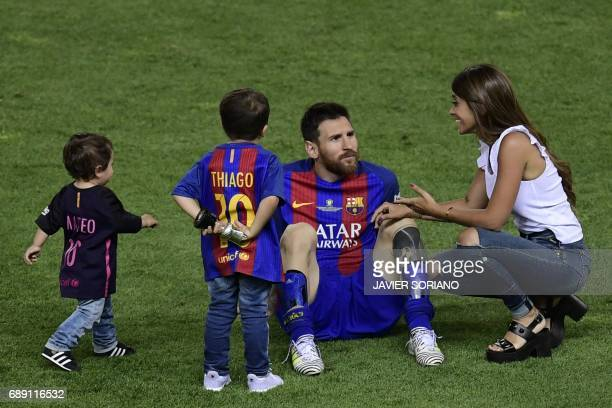 Barcelona's Argentinian forward Lionel Messi speaks with his wife Antonella Roccuzzo past their sons at the end of the Spanish Copa del Rey final...