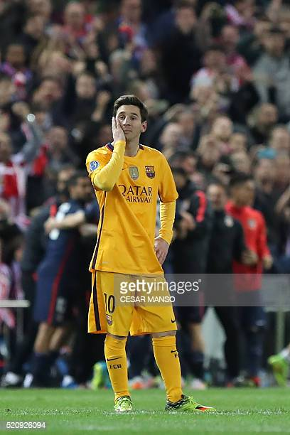 Barcelona's Argentinian forward Lionel Messi stands during the Champions League quarter-final second leg football match Club Atletico de Madrid vs FC...