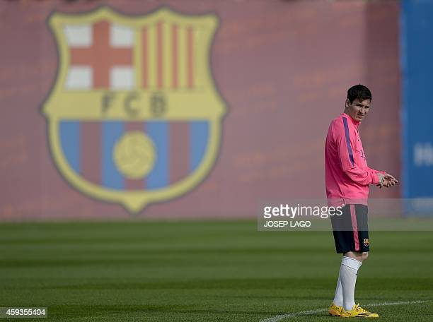 Barcelona's Argentinian forward Lionel Messi takes part in a training session at the Sports Center FC Barcelona Joan Gamper in Sant Joan Despi, near...
