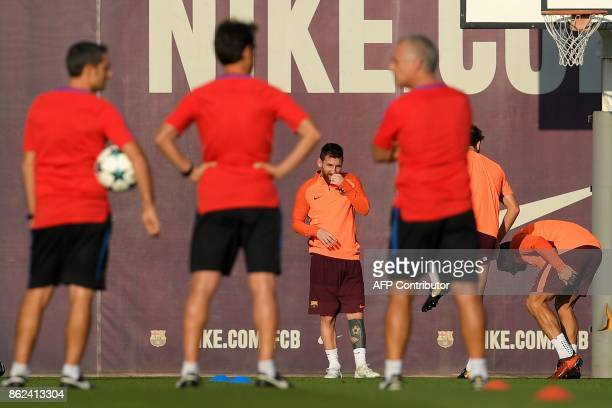 Barcelona's Argentinian forward Lionel Messi takes part in a training session at the Joan Gamper Sports Center in Sant Joan Despi near Barcelona on...