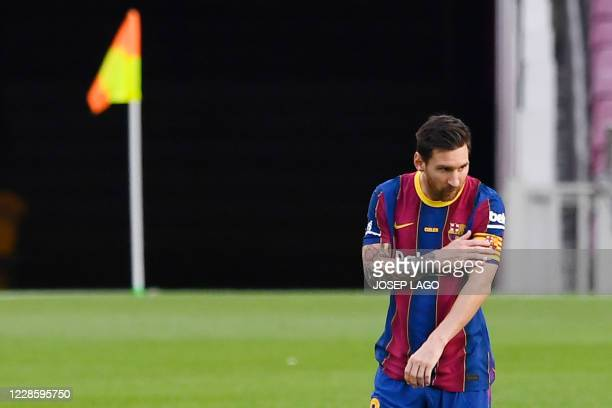 Barcelona's Argentinian forward Lionel Messi touches his captain's armband during the 55th Joan Gamper Trophy friendly football match between...
