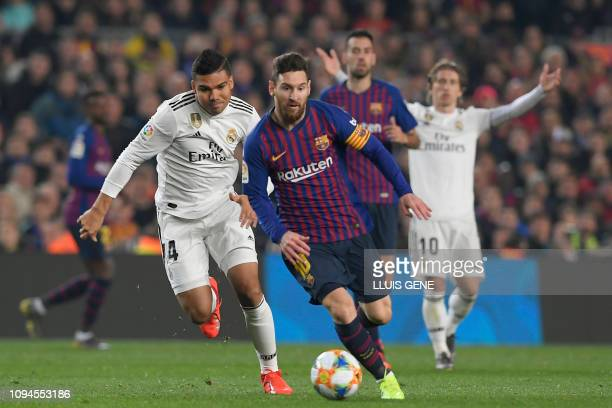Barcelona's Argentinian forward Lionel Messi vies for the ball with Real Madrid's Brazilian midfielder Casemiro during the Spanish Copa del Rey...