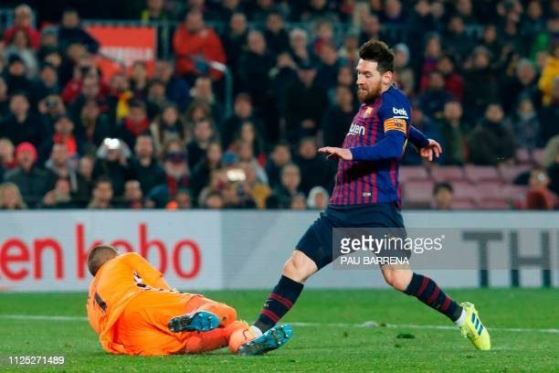 Barcelona's Argentinian forward Lionel Messi vies for the ball with Real Valladolid's Spanish goalkeeper Jordi Masip during the Spanish League...