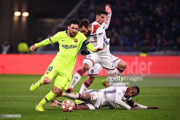 Barcelona's Argentinian forward Lionel Messi vies for the ball with Lyon's French midfielder Lucas Tousart Lyon's French midfielder Houssem Aouar and...