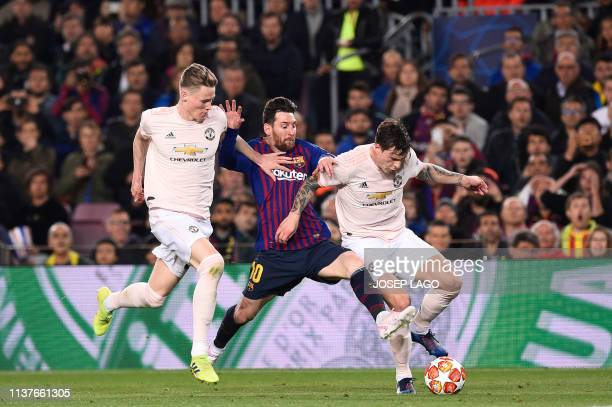 Barcelona's Argentinian forward Lionel Messi vies for the ball with Manchester United's Scottish midfielder Scott McTominay and Manchester United's...