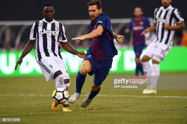 Barcelona's Argentinian forward Lionel Messi vies for the ball with Juventus' midfielder from Ghana Kwadwo Asamoah during the International Champions...