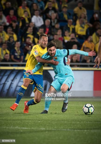 Barcelona's Argentinian forward Lionel Messi vies Las Palmas' defender Daniel Castellano Betancor during the Spanish league football match UD Las...