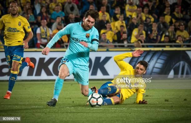 Barcelona's Argentinian forward Lionel Messi vies Las Palmas' defender Ximo Navarro Jimenez during the Spanish league football match UD Las Palmas vs...