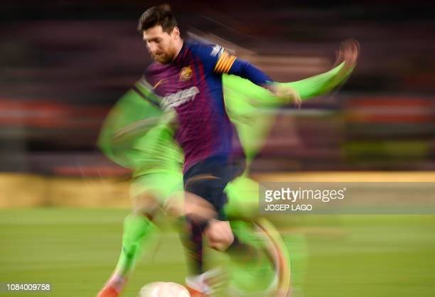TOPSHOT Barcelona's Argentinian forward Lionel Messi vies with a player of Levante UD during the Spain's Copa del Rey round of 16 second leg football...