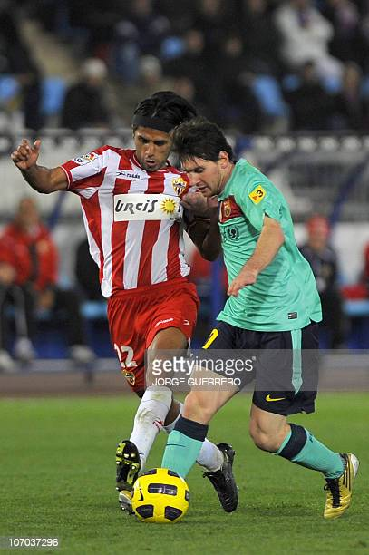Barcelona's Argentinian forward Lionel Messi vies with Almeria's Colombian midfielder Fabian Vargas during their Spanish league football match at...