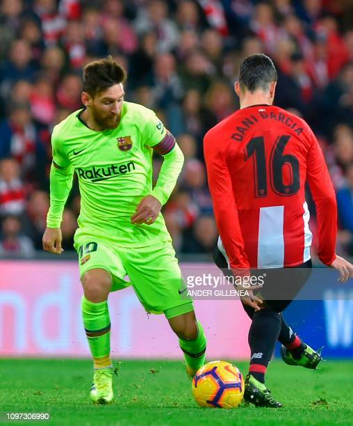 Barcelona's Argentinian forward Lionel Messi vies with Athletic Bilbao's Spanish midfielder Dani Garcia during the Spanish league football match...