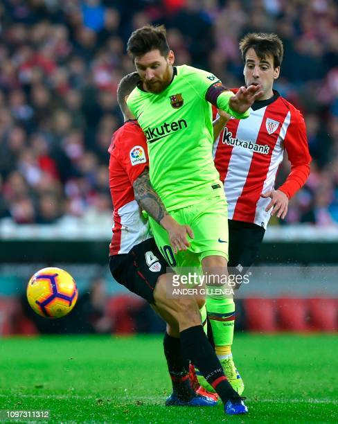 Barcelona's Argentinian forward Lionel Messi vies with Athletic Bilbao's Spanish defender Inigo Martinez during the Spanish league football match...