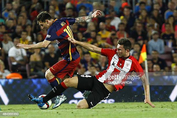 Barcelona's Argentinian forward Lionel Messi vies with Athletic Bilbao's defender Aymeric Laporte during the Spanish Supercup secondleg football...