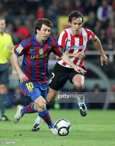 Barcelona's Argentinian forward Lionel Messi vies with Athletic Bilbao's midfielder David Lopez during their Spanish League football match at the...