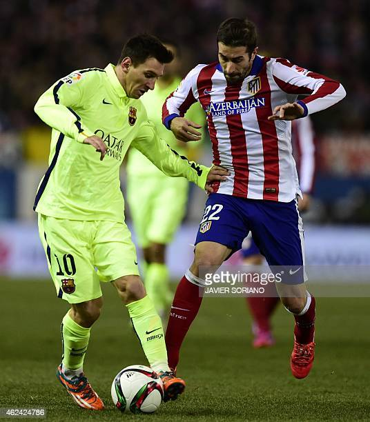Barcelona's Argentinian forward Lionel Messi vies with Atletico Madrid's midfielder Cani during the Spanish Copa del Rey quarter final second leg...