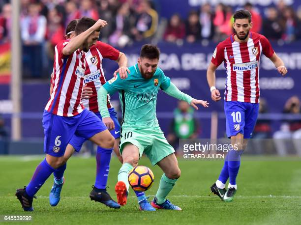 TOPSHOT Barcelona's Argentinian forward Lionel Messi vies with Atletico Madrid's midfielder Koke during the Spanish league football match Club...