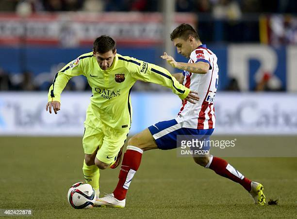 Barcelona's Argentinian forward Lionel Messi vies with Atletico Madrid's Brazilian defender Guilherme Siqueira during the Spanish Copa del Rey...