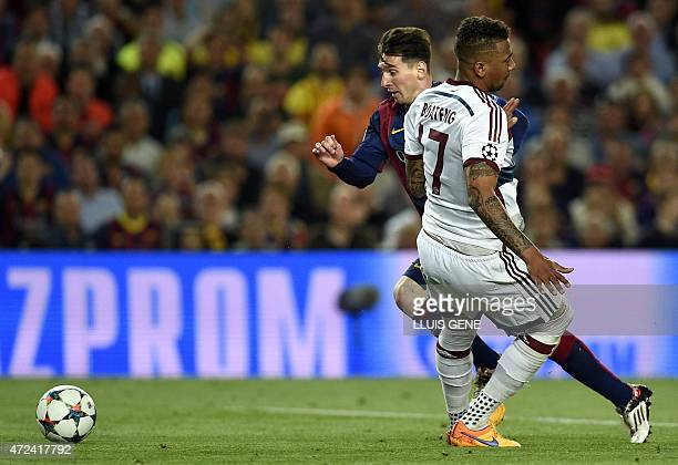 Barcelona's Argentinian forward Lionel Messi vies with Bayern Munich's defender Jerome Boateng during the UEFA Champions League football match FC...