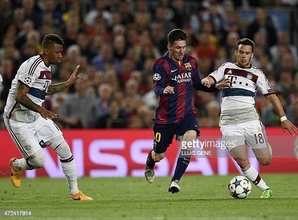 Barcelona's Argentinian forward Lionel Messi vies with Bayern Munich's Spanish defender Juan Bernat as Bayern Munich's defender Jerome Boateng...