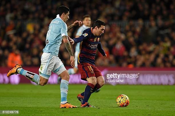 Barcelona's Argentinian forward Lionel Messi vies with Celta Vigo's Chilean midfielder Pablo Hernandez during the Spanish league football match FC...