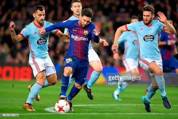 Barcelona's Argentinian forward Lionel Messi vies with Celta Vigo's Spanish defender Jonny Castro and Celta Vigo's Spanish defender Sergi Gomez...
