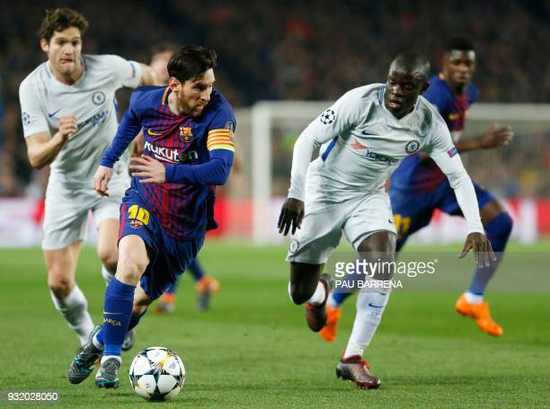Barcelona's Argentinian forward Lionel Messi vies with Chelsea's French midfielder N'Golo Kante during the UEFA Champions League round of sixteen...
