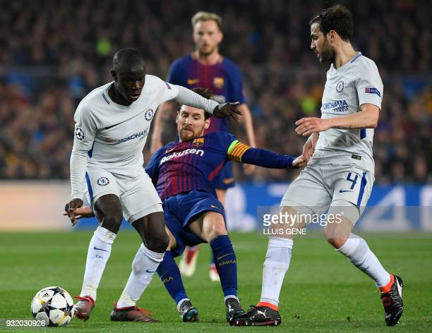 Barcelona's Argentinian forward Lionel Messi vies with Chelsea's French midfielder N'Golo Kante and Chelsea's Spanish midfielder Cesc Fabregas during...