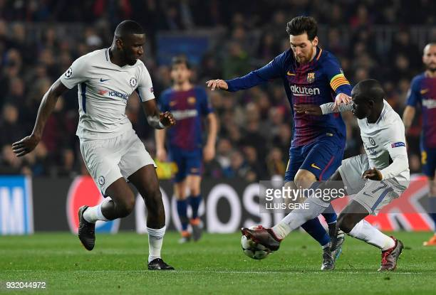 Barcelona's Argentinian forward Lionel Messi vies with Chelsea's German defender Antonio Rudiger and Chelsea's French midfielder N'Golo Kante during...