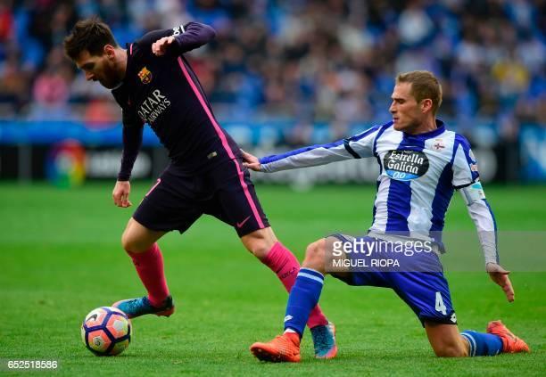 Barcelona's Argentinian forward Lionel Messi vies with Deportivo La Coruna's midfielder Alex Bergantinos during the Spanish league footbal match RC...