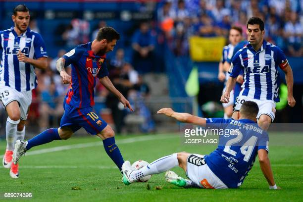Barcelona's Argentinian forward Lionel Messi vies with Deportivo Alaves' Moroccan defender Zouhair Feddal during the Spanish Copa del Rey final...
