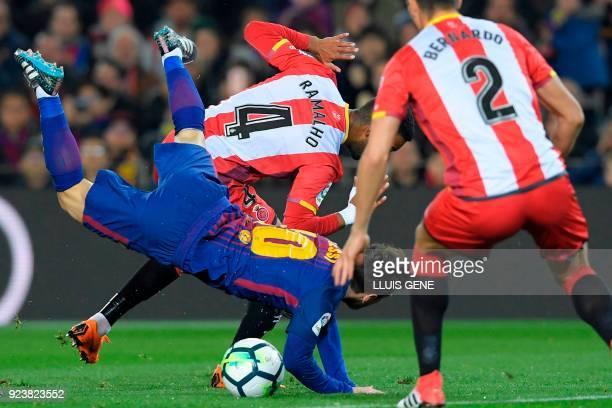 TOPSHOT Barcelona's Argentinian forward Lionel Messi vies with Girona's Spanish defender Jonas Ramalho during the Spanish league football match...