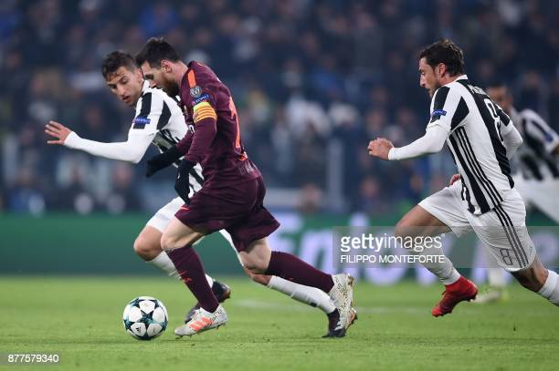 Barcelona's Argentinian forward Lionel Messi vies with Juventus' midfielder from Uruguay Rodrigo Bentancur during the UEFA Champions League Group D...