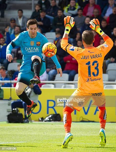 Barcelona's Argentinian forward Lionel Messi vies with Las Palmas' goalkeeper Javi Varas during the Spanish league football match UD Las Palmas vs FC...