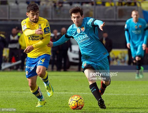 Barcelona's Argentinian forward Lionel Messi vies with Las Palmas' midfielder Hernan Santana during the Spanish league football match UD Las Palmas...