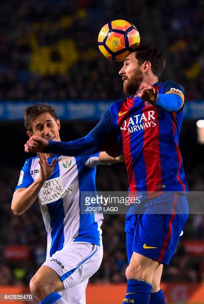 Barcelona's Argentinian forward Lionel Messi vies with Leganes' Argentinian midfielder Alexander Szymanowski during the Spanish league football match...