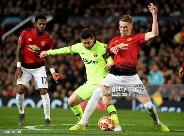Barcelona's Argentinian forward Lionel Messi vies with Manchester United's English midfielder Scott McTominay during the UEFA Champions league first...