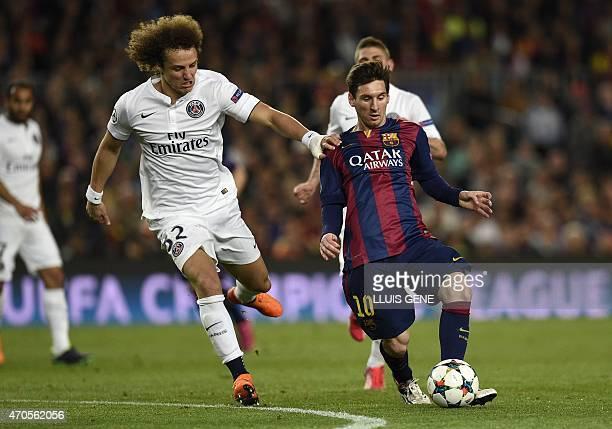Barcelona's Argentinian forward Lionel Messi vies with Paris Saint-Germain's Brazilian defender David Luiz during the UEFA Champions League...