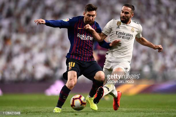 Barcelona's Argentinian forward Lionel Messi vies with Real Madrid's Spanish defender Dani Carvajal during the Spanish league football match between...