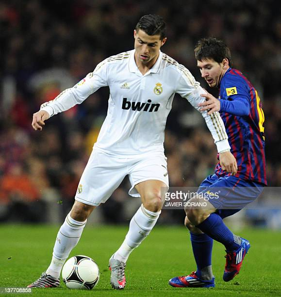 Barcelona's Argentinian forward Lionel Messi vies with Real Madrid's Portuguese forward Cristiano Ronaldo during the second leg of the Spanish Cup...