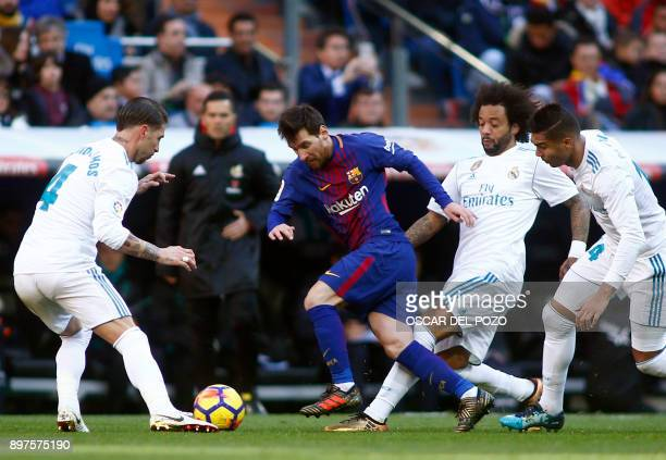 Barcelona's Argentinian forward Lionel Messi vies with Real Madrid's Spanish defender Sergio Ramos Real Madrid's Brazilian defender Marcelo and Real...