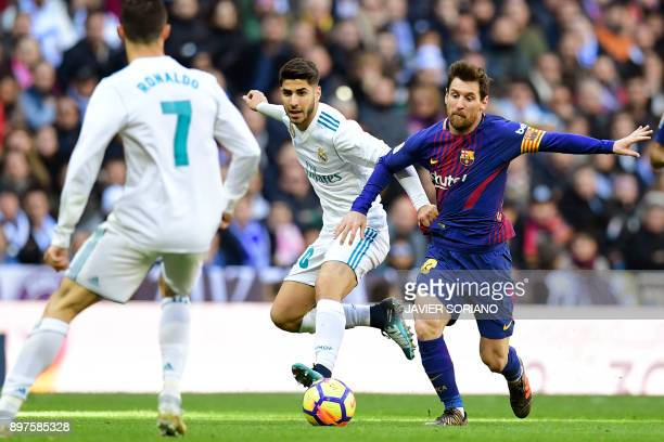 Barcelona's Argentinian forward Lionel Messi vies with Real Madrid's Spanish midfielder Marco Asensio during the Spanish League 'Clasico' football...