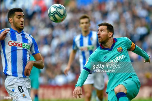 Barcelona's Argentinian forward Lionel Messi vies with Real Sociedad's Spanish midfielder Mikel Merino during the Spanish league football match...